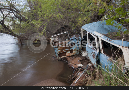 junk cars on river stock photo, consumerism and environment concept - junk wreck cars on the river shore (South Platte in Colorado) by Marek Uliasz