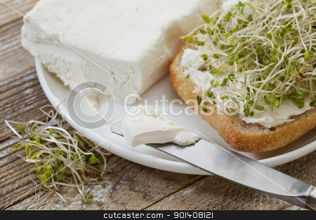 roll, cream cheese and broccoli sprouts stock photo, healthy breakfast concept - a roll with cream cheese and broccoli sprouts by Marek Uliasz