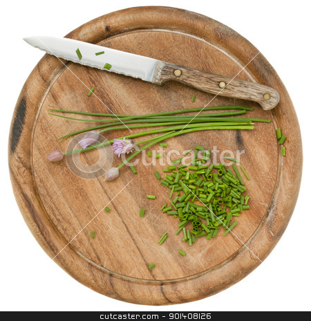 green chives chopped stock photo, green chives with flowers chopped on a wood cutting board, isolated on white by Marek Uliasz