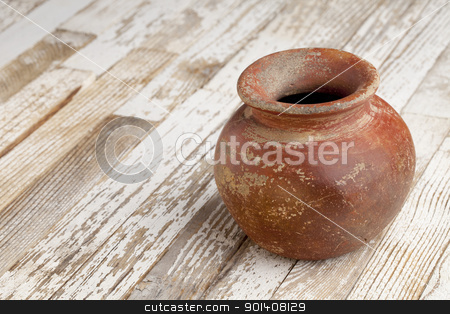 red clay pot on rustic table stock photo, small red and brown clay plant pot (mass produced planter) with rough, grunge finish,  on white wood background by Marek Uliasz