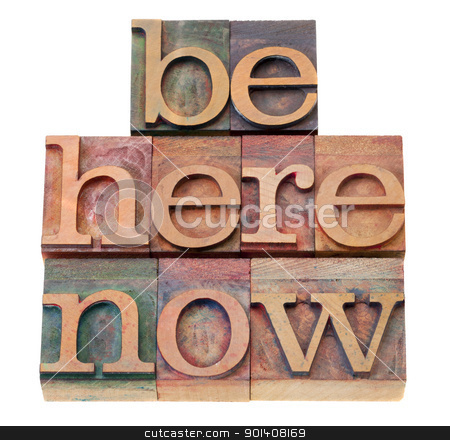 motivational reminder in letterpress type stock photo, be here now - motivational reminder - words  in vintage wood letterpress printing blocks, isolated on white by Marek Uliasz
