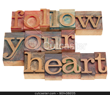 follow your heart stock photo, follow your heart phrase in vintage wood letterpress type, stained by color inks, isolated on white by Marek Uliasz