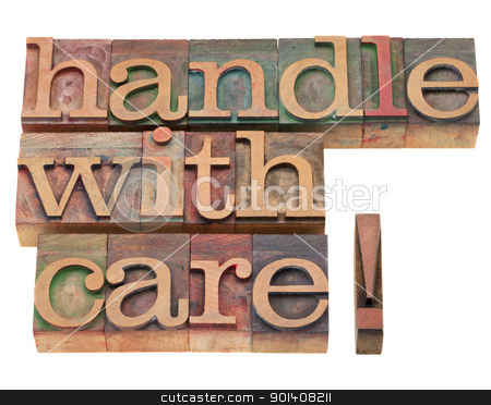 handle with care in letterpress type stock photo, handle with care warning in vintage wood letterpress printing blocks, isolated on white by Marek Uliasz