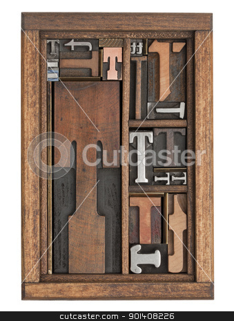 letter T abstract stock photo, letter T abstract - vintage letterpress printing blocks of different size and style in a wooden box with dividers by Marek Uliasz