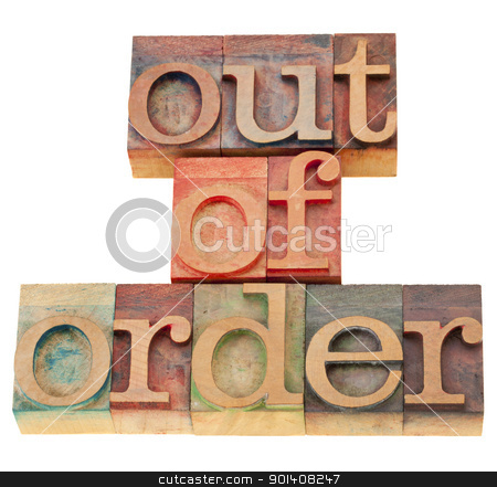 out of order in wood letterpress type stock photo, out of order  - isolated phrase in vintage wood letterpress printing blocks by Marek Uliasz