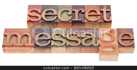 secret message in letterpress type stock photo, secret message phrase in vintage wood letterpress printing blocks isolated on white by Marek Uliasz