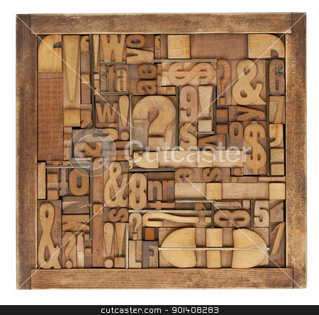 letterpress printing blocks abstract stock photo, box of vintage wood printing blocks - letters, numbers, symbols, punctuation marks, brass inserts by Marek Uliasz