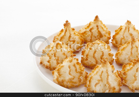 coconut macaroons stock photo, coconut macaroon cookies on white plate against tablecloth by Marek Uliasz