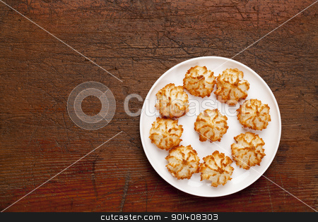coconut macaroon cookies stock photo, plate of coconut macaroon cookies on old scratched wooden table, top view by Marek Uliasz