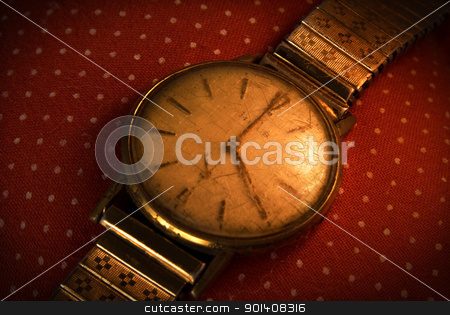 Vintage golden wristwatch. stock photo, Retro golden wristwatch close up on red vintage cloth background. by Cienpies Design