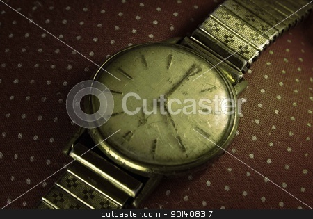 Vintage golden wristwatch. stock photo, Retro golden wristwatch close up on old fashioned cloth background. by Cienpies Design