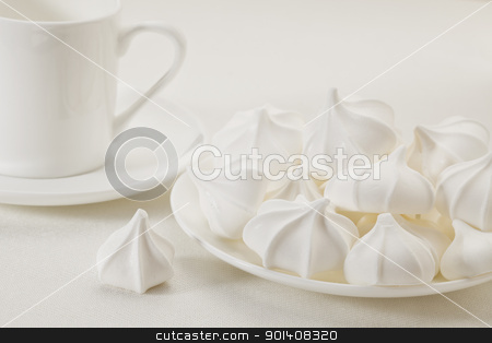 meringue cookies and coffee stock photo, plate of meringue cookies and espresso coffee cup on white tablecloth by Marek Uliasz