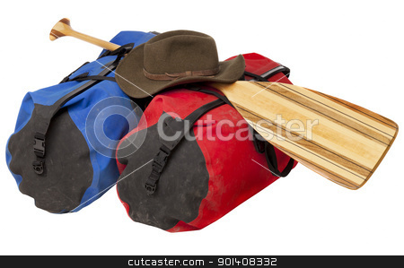 paddle, hat and waterproof luggage stock photo, paddling trip or vacation concept - wooden canoe paddle, waterproof duffels dirty by river mud and hat isolated on white by Marek Uliasz