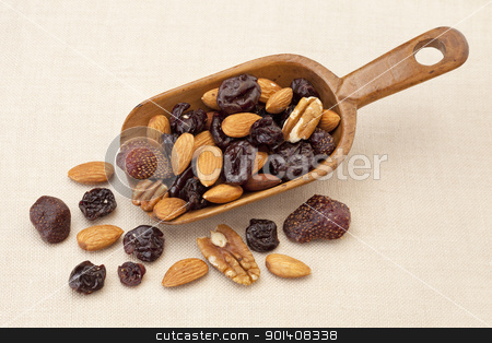 nuts and dried berries stock photo, rustic wooden scoop of healthy trail mix (almond, walnut, dried cherry and strawberry) by Marek Uliasz