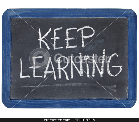 Keep learning on blackboard stock photo, Keep learning white chalk on a small slate blackboard isolated on white by Marek Uliasz