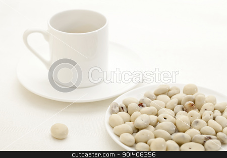 yogurt raisins and coffee stock photo, yogurt raisins snack and espresso coffee cup against white tablecloth by Marek Uliasz
