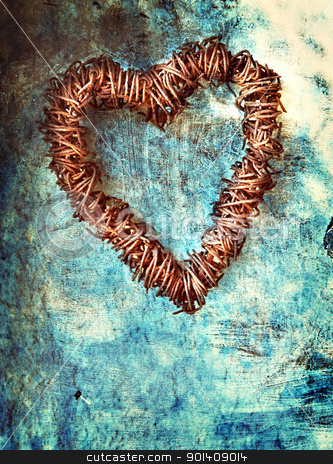 grunge heart on blue wall stock photo, rusted wire heart wreath on painted blue grunge wall background with space for text. by lubavnel