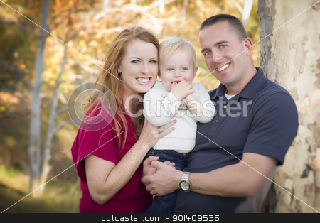Young Attractive Parents and Child Portrait stock photo, Young Attractive Parents and Child Portrait Outdoors. by Andy Dean