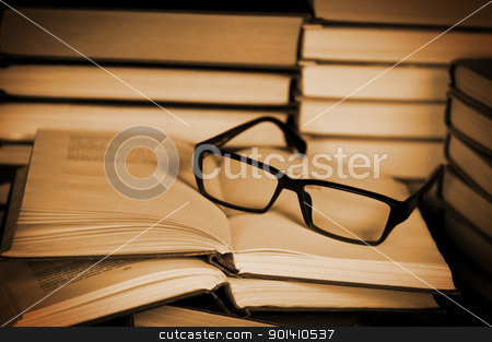 Glasses on open book. stock photo, Glasses on open book. Concept of reading and education. by Borys Shevchuk