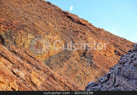 Golden Canyon Wall Moon Death Valley National Park California stock photo, Golden Canyon Wall Moon Death Valley National Park California by William Perry