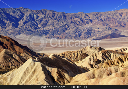 Moon Over Zabruski Point Death Valley National Park California stock photo, Moon Over Zabriski Point Mudstones form Badlands  Death Valley National Park California by William Perry