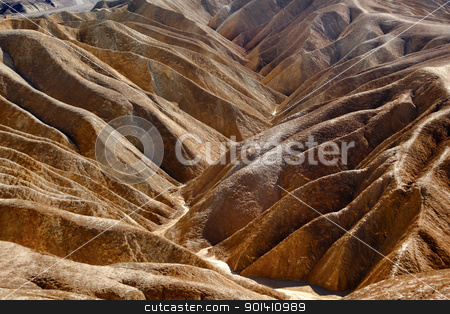 Zabruski Point Road Death Valley National Park California stock photo, Zabriski Point Road Mudstones form Badlands  Death Valley National Park California by William Perry