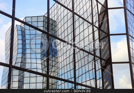 reflections in glass facade stock photo, building of glass and steel and clouds reflected in glass facade   by anton havelaar