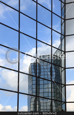 building and clouds reflected stock photo, Glass and steel building reflected in glass wall by anton havelaar