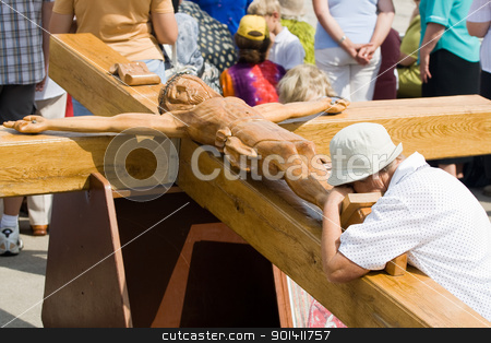 Praying woman at large wooden crucifix stock photo, AGLONA - AUGUST 15: Praying woman at large wooden crucifix. Day of the Assumption of Mary (15 August, 2008) Aglona, Latvia. by Ints Vikmanis