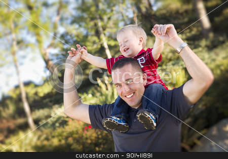 Young Laughing Father and Child Piggy Back stock photo, Young Laughing Father and Child  Having Piggy Back Fun. by Andy Dean