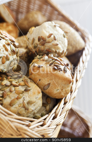 Basket of bread stock photo, Close up of a basket of bread by Anne-Louise Quarfoth