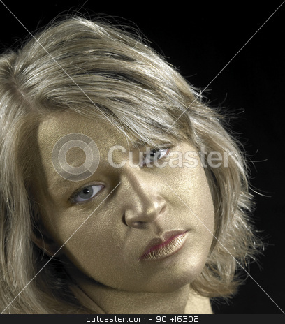 young woman with golden face stock photo, sad lookong girl with golden bodypainted face in black back by prill