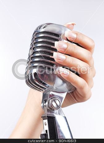 Big microphone in woman's hand stock photo, Big retro microphone in woman's hand by iMarin