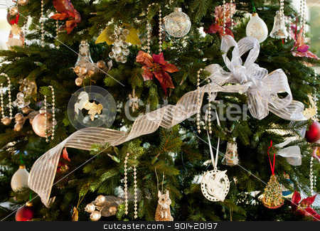 Decorated christmas tree in home stock photo, Christmas tree decorated with silver and white ribbons and ornaments in family home by Steven Heap