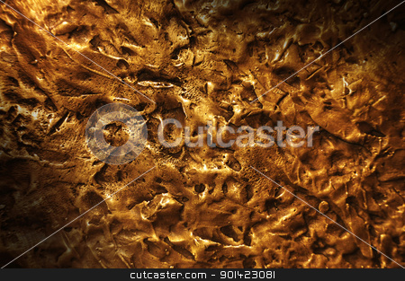 Bronze textured surface lit diagonally stock photo, Close-up on a bronze surface texture lit diagonally by J.R. Bale