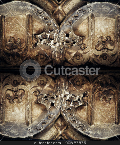 Ornamental texture  stock photo, Ornamental texture of metal and stone on a wall by Illogical Conversions