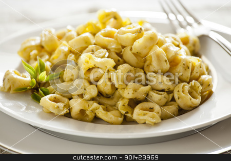 Tortellini and Basil stock photo, Close up Photograph of a Pesto Tortellini Meal  by mpessaris