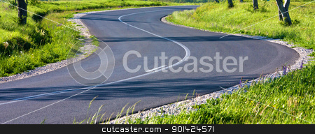 Asphalt road  stock photo, Beautiful curved asphalt road on sunny day by ARPAD RADOCZY