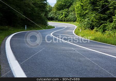 asphalt road stock photo, Straight asphalt road leading into the distance by ARPAD RADOCZY