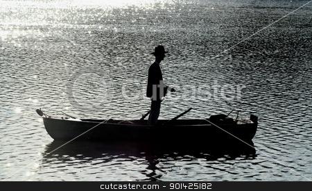 silhouette of man fishing stock photo, silhouette of man fishing by Paul Prescott