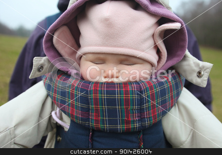 Baby sleeping in carrier stock photo, Baby sleeping in carrier with cap in winter season by Paul Prescott