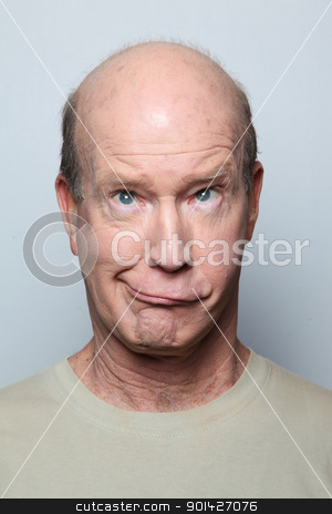 grimacing stock photo, Man making funny face and grimacing by Paul Prescott