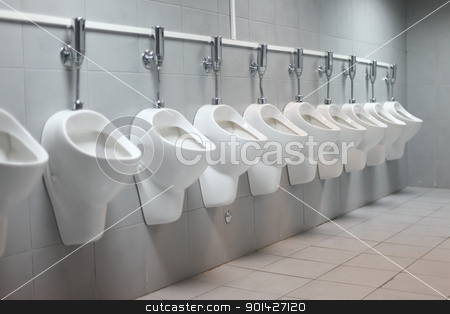 toilet urinal stock photo, line of white porcelain urinals in public toilets by Paul Prescott