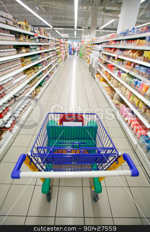 supermarket perspective stock photo, Supermarket cart traveling down the aisle for a shop by Paul Prescott