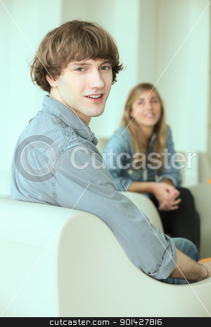 Teenagers hanging out in a lounge stock photo, Teenagers hanging out in a lounge by photography33