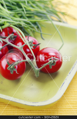 tomatoes and chives stock photo, organic cherry tomatoes and A bunch of fresh chives  on old green plate by klenova