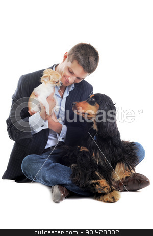 man and dogs stock photo, man withe a  purebred english cocker and chihuahua  in a studio by Bonzami Emmanuelle