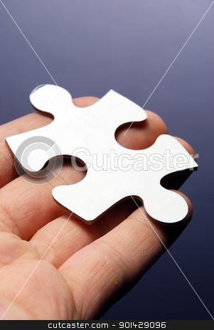 Hand holding a puzzle piece stock photo, Hand holding a puzzle piece high resolution image by sutike