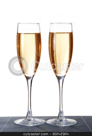 Two elegant champagne glasses on a dark surface stock photo, Two elegant champagne glasses on a dark surface by sutike
