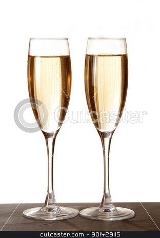 Two elegant champagne glasses stock photo, Two elegant champagne glasses on a dark surface by sutike